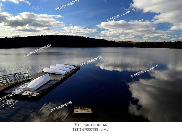 Cloud reflection over boat dock Jamaica Pond