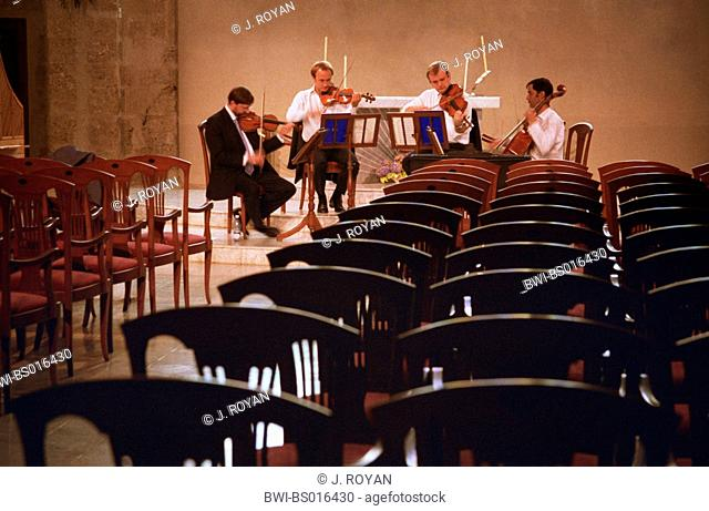 string quartet at the rehearsal in a concert hall, Cuba