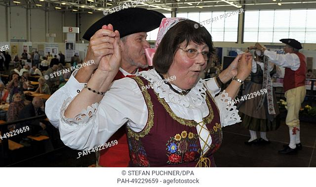 A group of people costumed in traditional clothing dance during the day of Sudeten-Germans in Augsburg, Germany, 08 June 2014