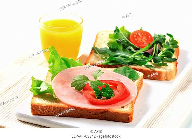 Bread with ham and salad greens
