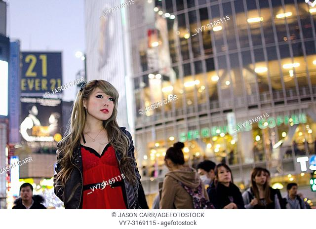 Japanese Girl poses on the street in Shibuya, Japan. Shibuya is a town which young people hang out and go shopping