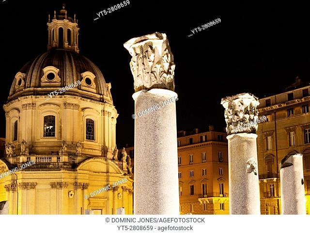 The illuminated dome of Santissimo Nome di Maria al Foro Traiano Church sits behind Trajan's Forum, Rome, Italy, Europe