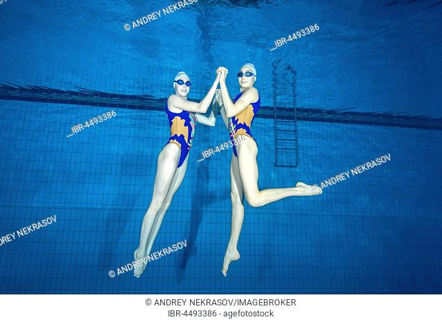 Underwater view of Synchronized Swimming in a swimming pool, Ukraine