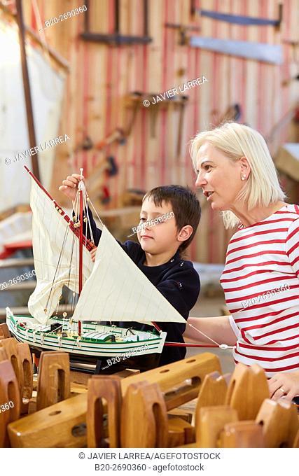 Grandmother and grandson, Building model sailboat, Whaleship, Pasaia, Gipuzkoa, Basque Country, Spain, Europe