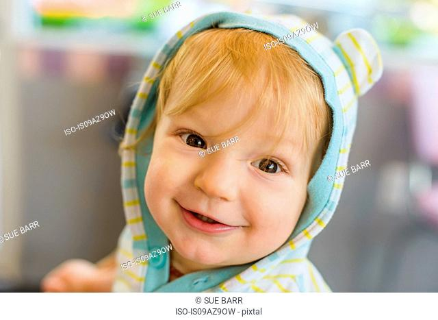Portrait of baby boy looking at camera smiling