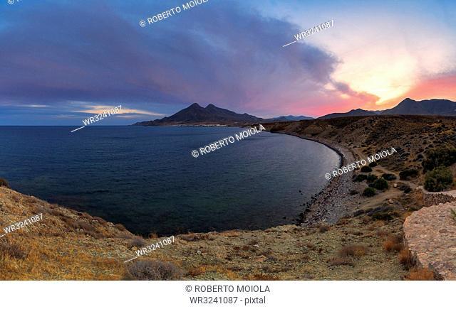 Coastline of La Isleta del Moro at sunset in Cabo de Gata-Nijar Natural Park, Spain, Europe