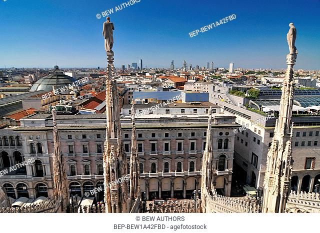 View of Milan skyline spires and statues from the top of Milan Cathedral, Italy