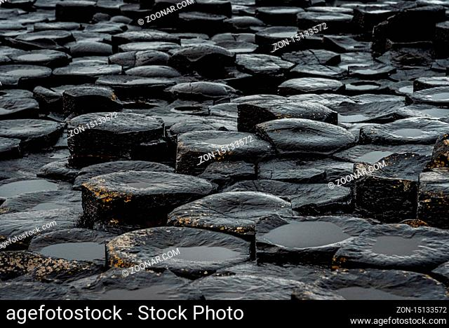 Close up of the natural hexagonal stones at the coast called Giant's Causeway, a landmark in Northern Ireland