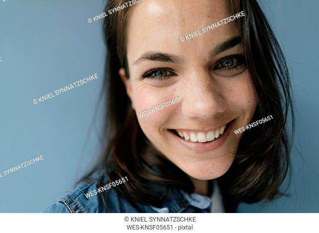 Portrait of a woman, smiling happily