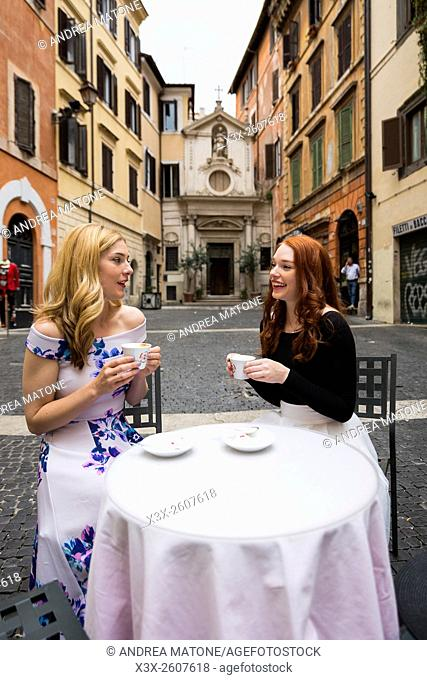 Girlfriends having coffee in Rome Italy