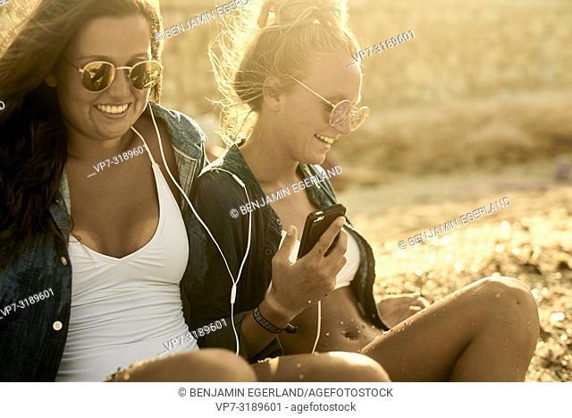 Two women at beach, Chersonissos, Crete, Greece