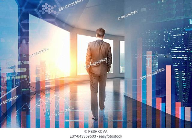Trade and broker concept. Businessman in modern office interior with abstract forex chart. Double exposure