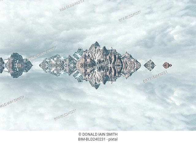 Mirror image of mountains and clouds