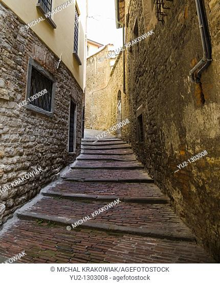 Narrow alley between buildings in Bergamo, Italy