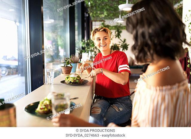 female friends eating at restaurant