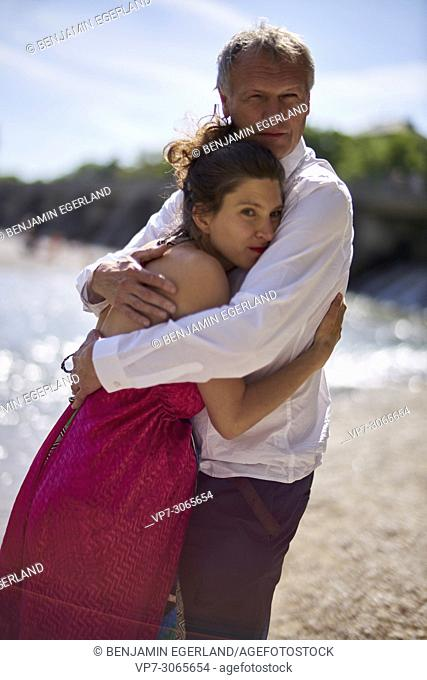 Couple, pregnancy, age difference. At river Isar, Munich, Germany