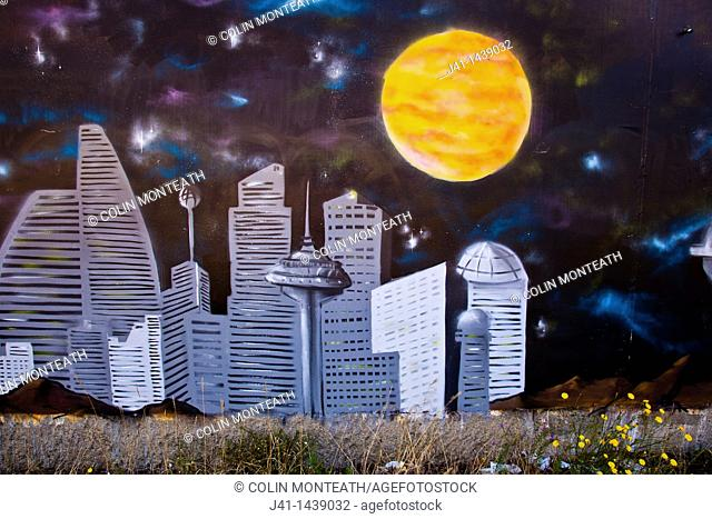 Street art, graffiti, cityscape and full moon, near railway tracks, Christchurch, New Zealand