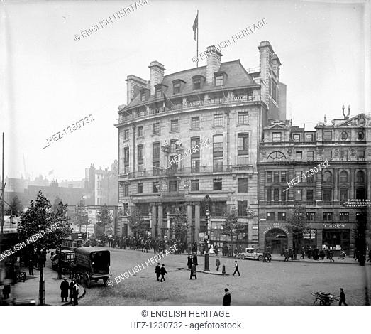A crowd has gathered outside General Buildings, Aldwych, headquarters of the General Accident Fire and Life Assurance Corporation