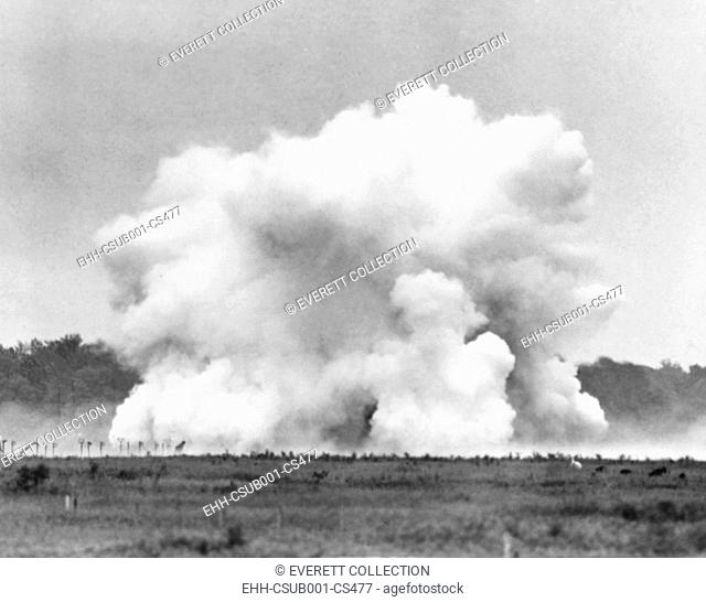 The explosion of Lester P. Barlow's 'GLMITE' bomb at Aberdeen Proving Ground, Maryland. The 1,000 pound liquid oxygen bomb created an powerful roar