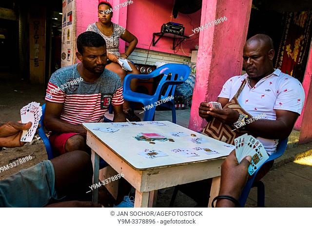 Afro-Colombian market vendors play cards at the end of the day in the market of Bazurto in Cartagena, Colombia, 5 December 2018