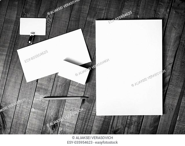 Photo of blank corporate stationery template on wood background. Brand ID set. Top view