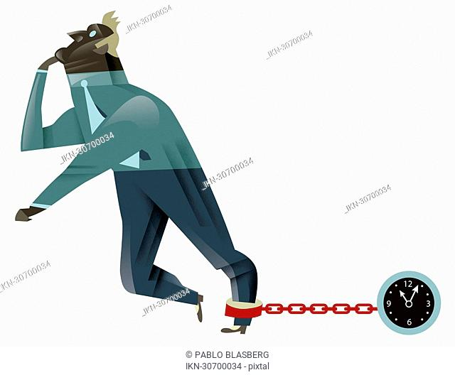 Businessman pulling clock-shaped ball and chain