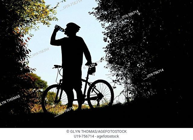 Mountain biker drinking