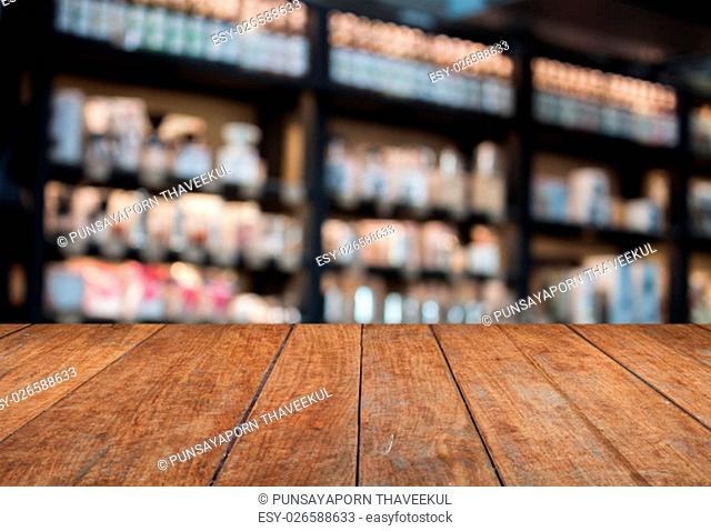 Perspective top wooden with blurred cafe background. product display template