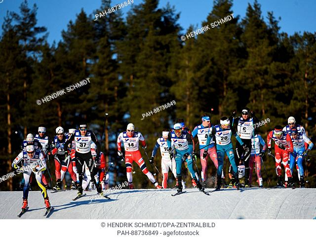Athletes in action during the men's 50 km mass start freestyle cross-country event at the Nordic Ski World Championship in Lahti, Finland, 5 March 2017