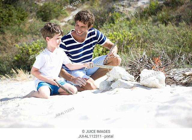 Family building campfire on beach
