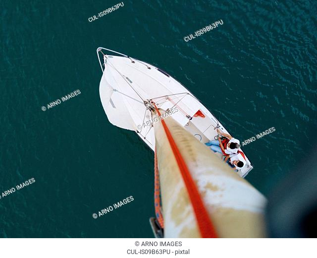 Man and woman on sailing boat on lake, overhead view