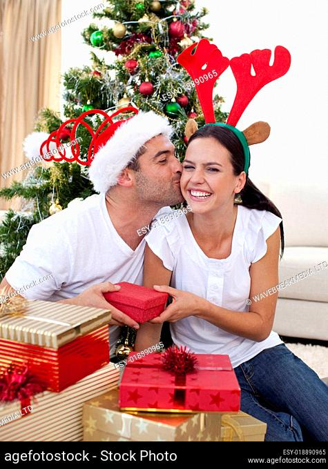 Smiling couple giving presents for Christmas