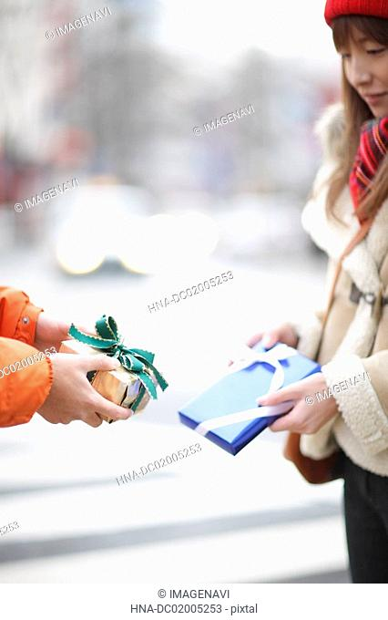 Couple giving presents each other