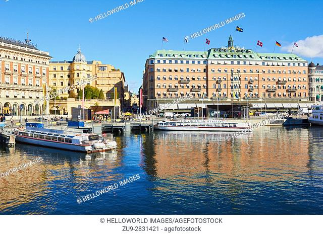 Five star Grand Hotel, opened in 1874 and ferries moored on waterfront, Norrmalm, Stockholm, Sweden, Scandinavia