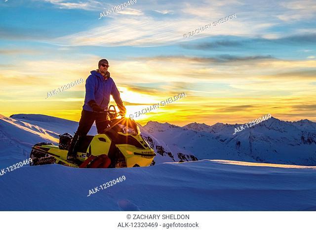 A man gazes out over the Chugach Mountains, from atop Hogsback, near Valdez, Southcentral Alaska, USA