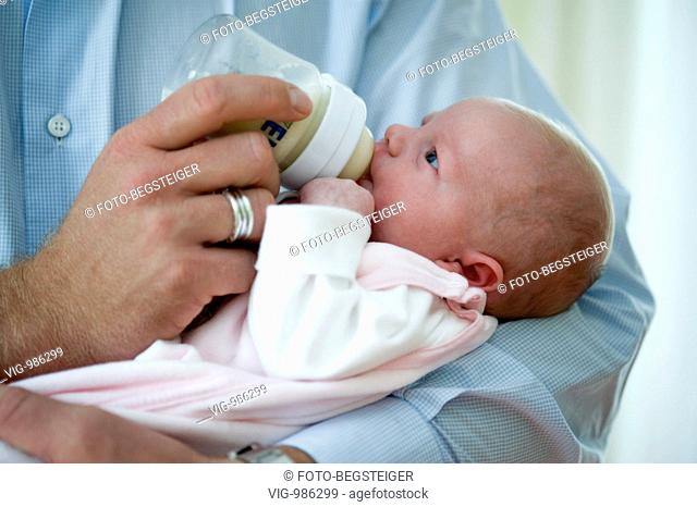 father feeding baby with milk. - 02/09/2008