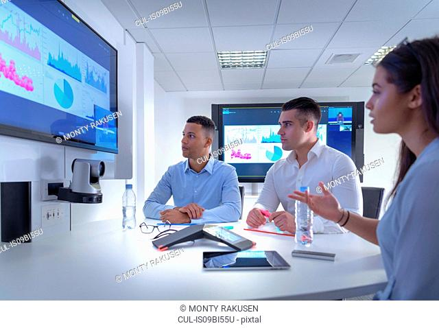 Business team using video conferencing, graphs and charts in business meeting