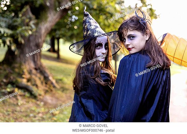 Portrait of two masquerade girls at Halloween