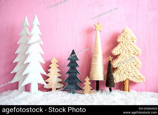 Vintage Christmas Trees. Pink Grungy Wooden Rustic Background With Snow. Christmas Decoration With Stars