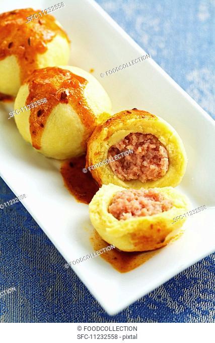 Sausagemeat hash dumplings with goulash sauce (Austria)