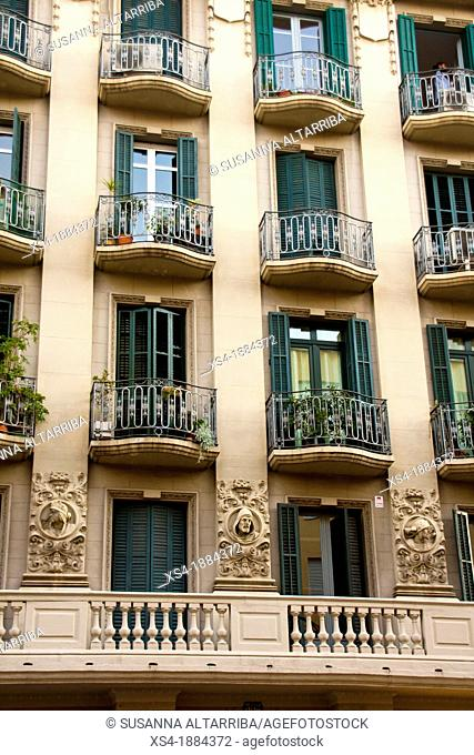 Façade decorated with borders overloaded with 3 faces of men that looking at street Constructed in 1935 Mallorca street nº 352