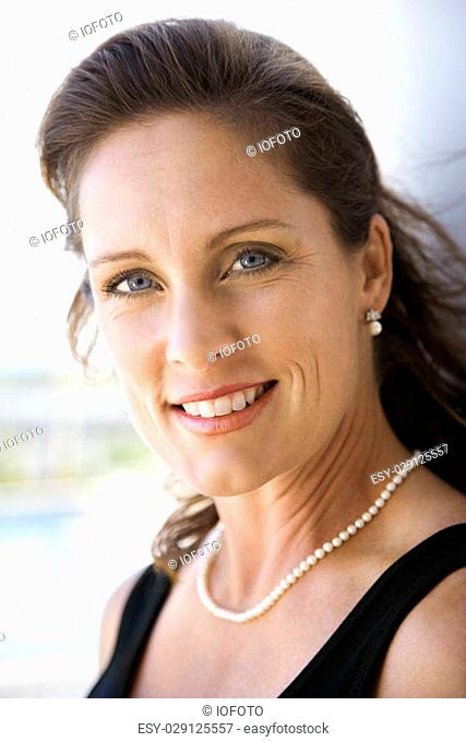 Portrait of mid-adult Caucasian female smiling and making eye contact