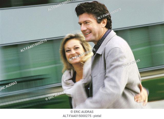 Middle aged couple walking, blurred motion