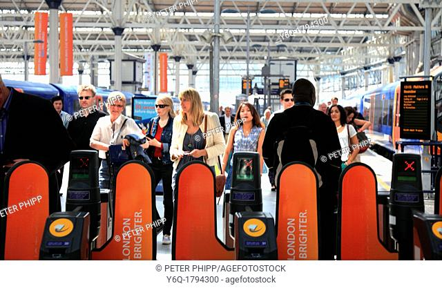 Commuters arriving at Waterloo Station in London UK