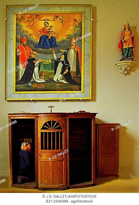 Woman confessing to a priest in the church of Theillay, Loir-et-Cher, Centre-Val de Loire, France