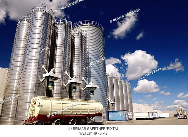 Large stainless steel tanks and trucks containing plastic ingredients for extrusion industry