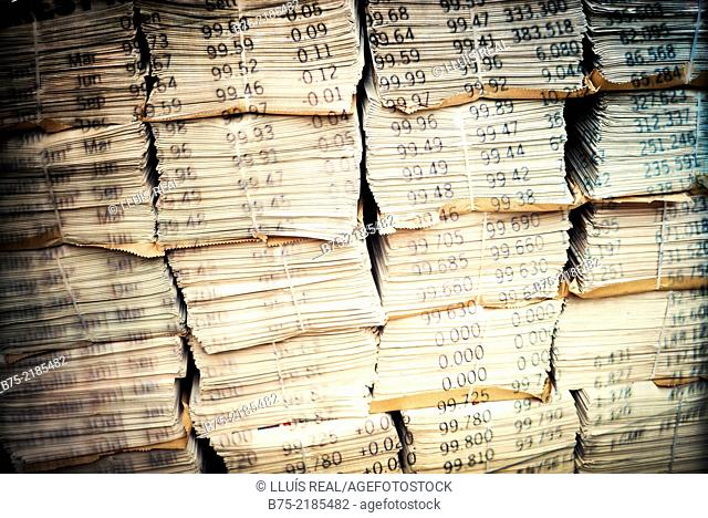 digital composition of a lot of newspapers with superimposed numbers of stock-exchange