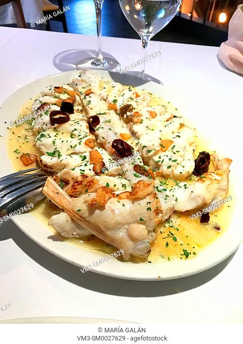 Grilled monkfish with garlic and olive oil. Spain