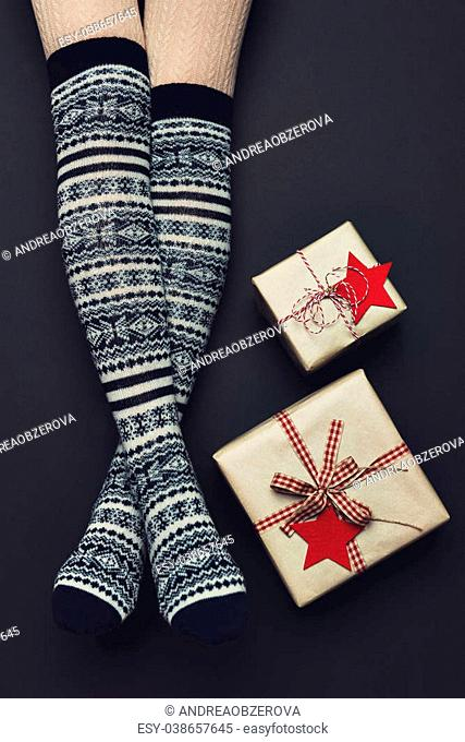 Long sexy woman legs with xmas over the knee socks. Christmas holiday concept. Top view