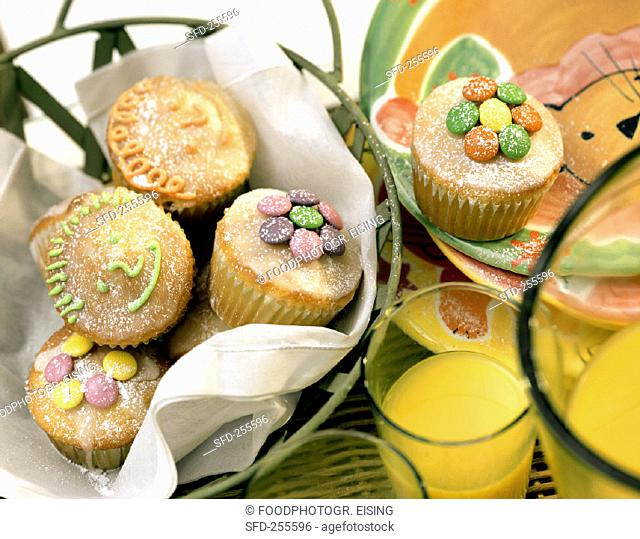 Lemon muffins with coloured chocolate buttons (1)